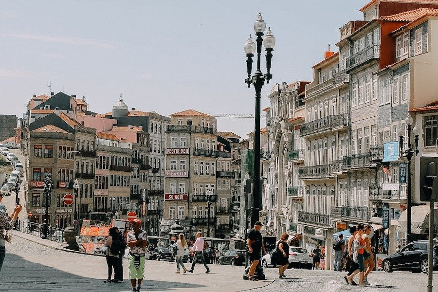 Various buildings in Porto with people walking around