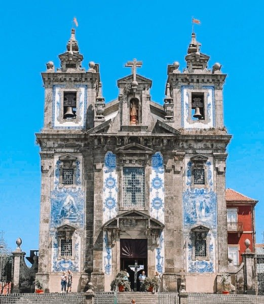 Old gothic church with blue tiles decorating it