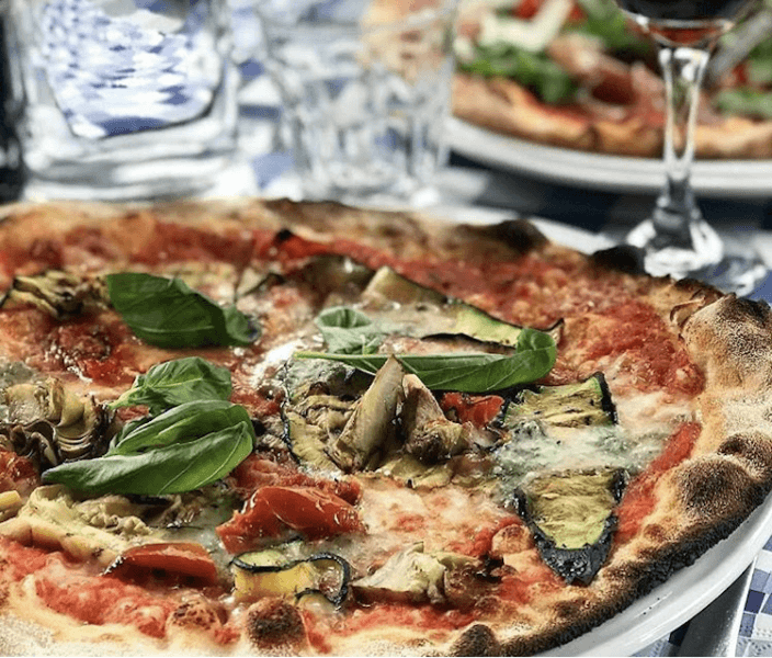 Pizza with eggplant and basil on top
