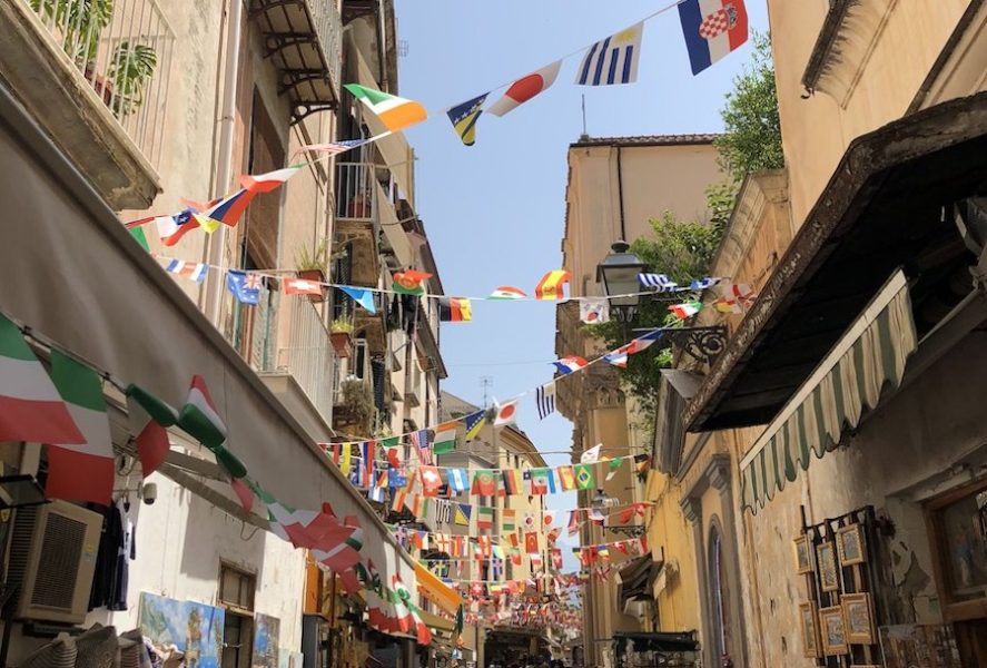 Narrow Sorrento streets with various little country flags overhead