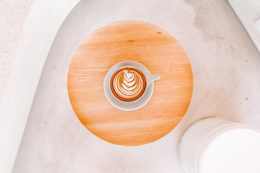 Ariel view of cappuccino on a wooden table