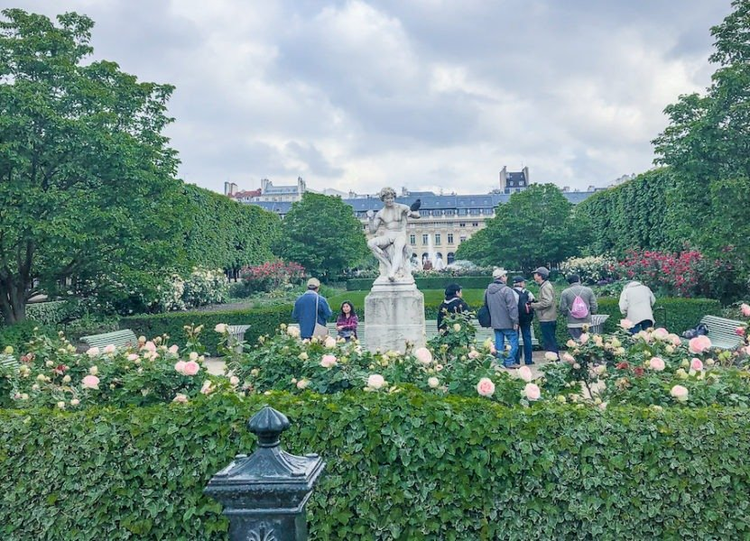 Lush green gardens and stone statue