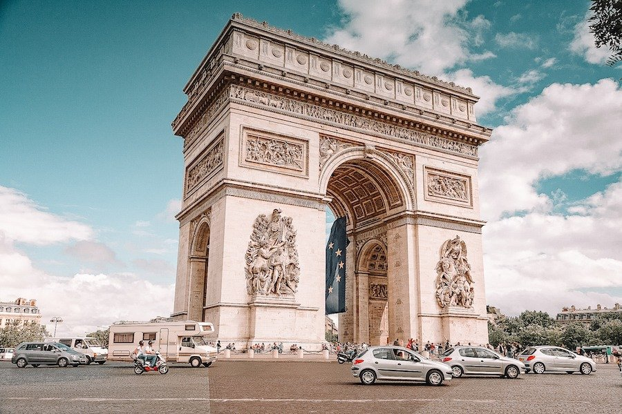 The Arc de Triomphe from the front with cars driving around it