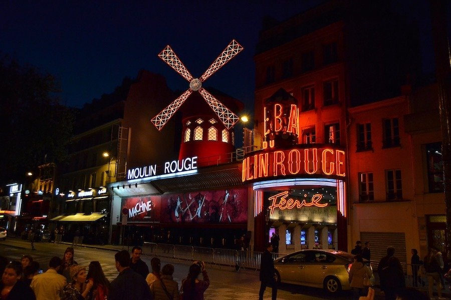 Moulin Rouge from the outside with red lights and old windmill