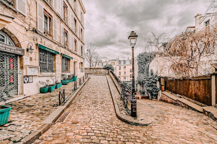 Cobblestone streets and old street lamp