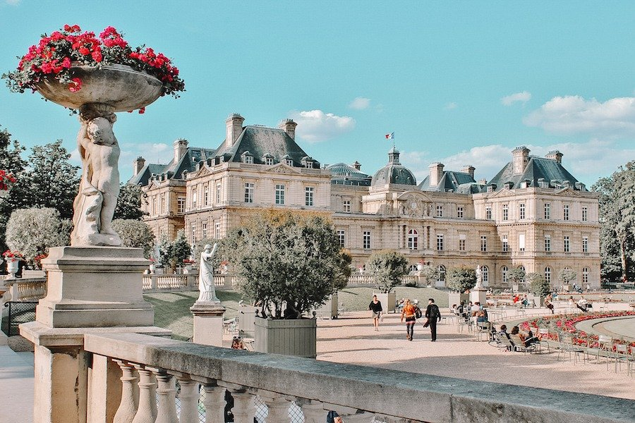 Luxembourg Palace and people walking around during one weekend in Paris