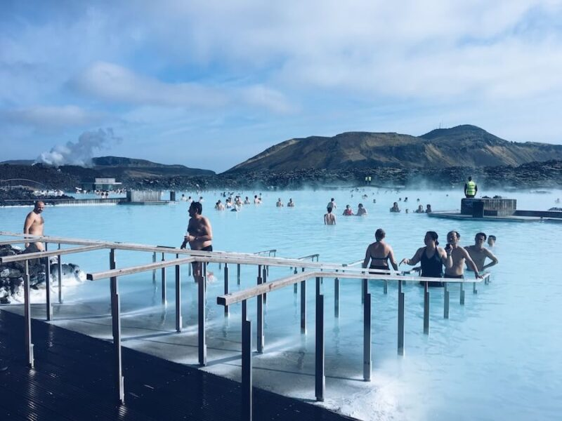 Various people in the milky blue waters of the Blue Lagoon in Iceland