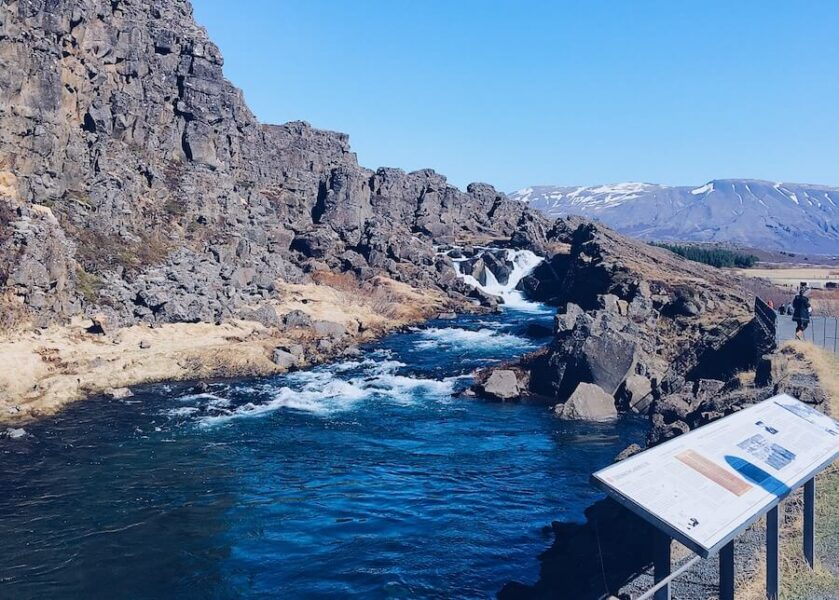 Large rock walls and vivid blue waters at Þingvellir National park