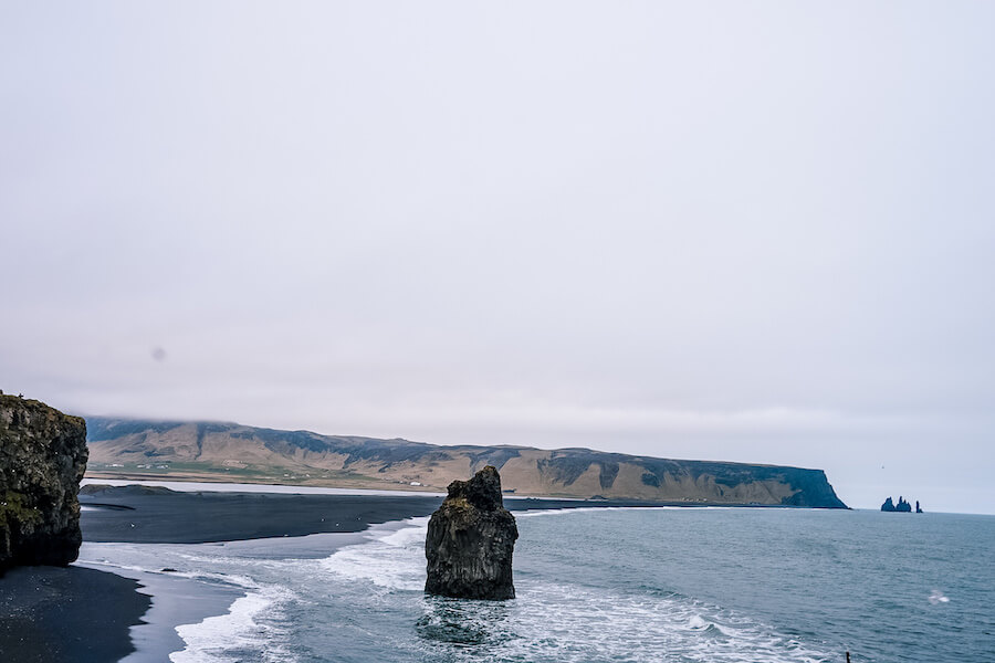 Side view of the black sand beach