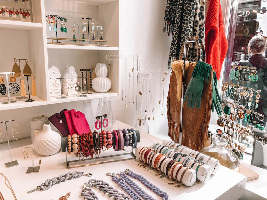 Colorful jewelry, scarfs, gloves and more inside a store in Amsterdam
