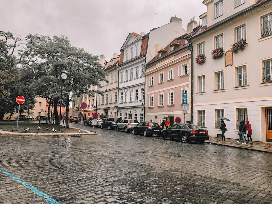 Pastel coloured houses lining a street in Prague