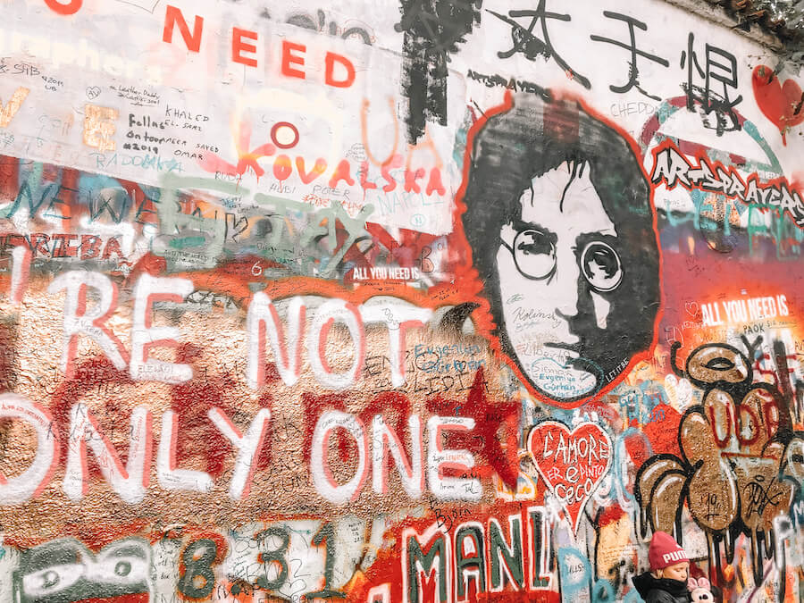 John Lennon Wall covered in artistic drawings, words, and John Lennons face