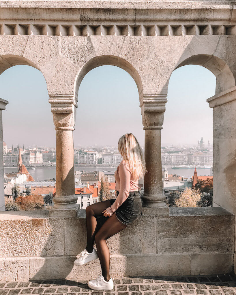 Girl sitting on the edge of Fishermans Bastion