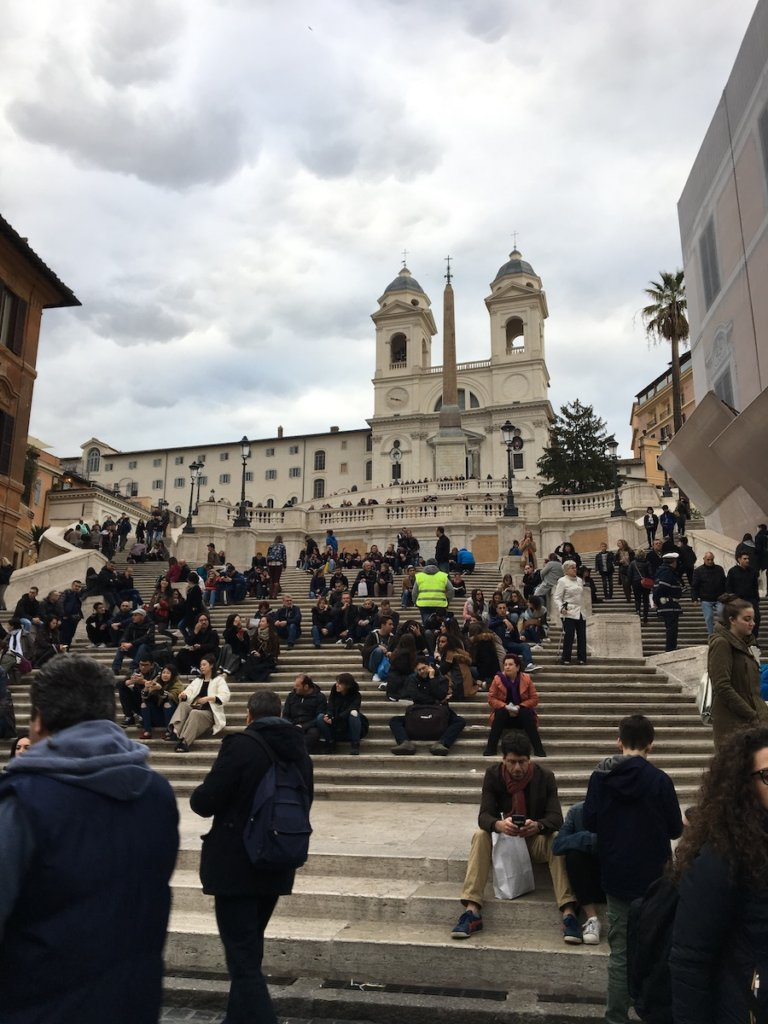 View from the bottom of the Spanish steps with people sitting on them