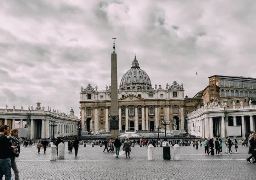 St. Peter's Basilica inVatican city with people walking around