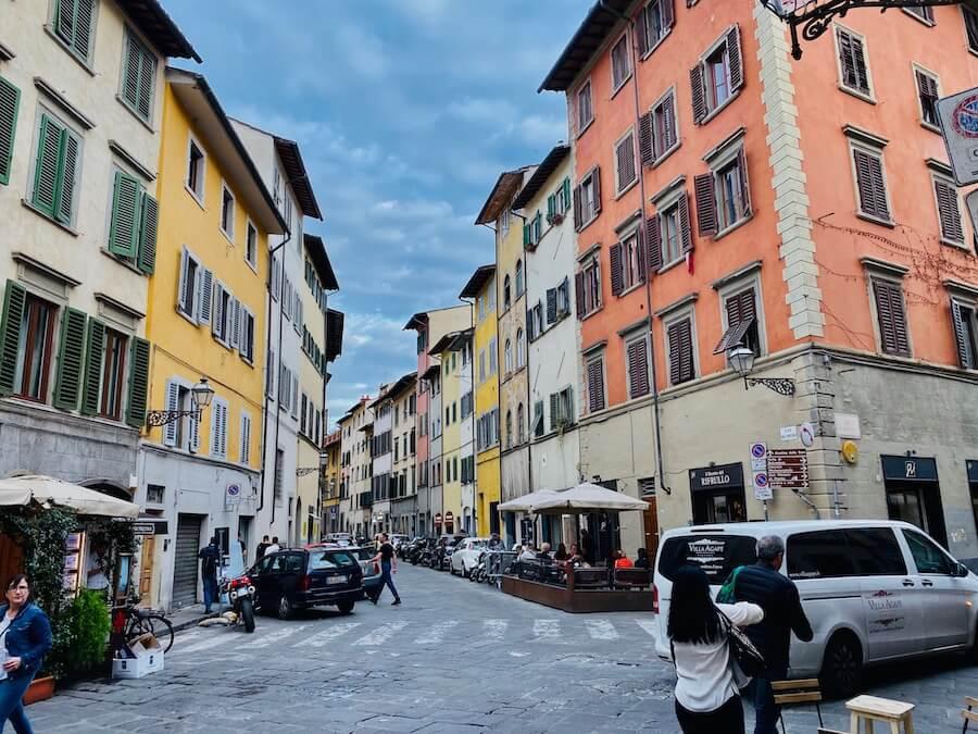 Pastel coloured houses along a street
