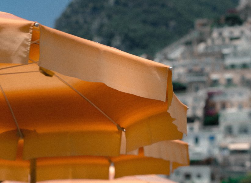 Orange umbrellas on a beach in Positano