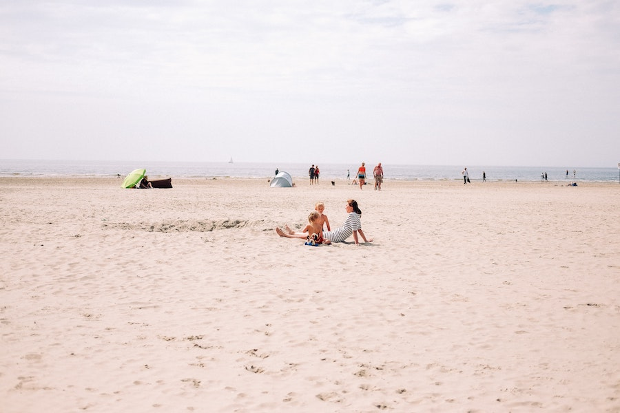 Mother and sons sitting on the IJmudien beach