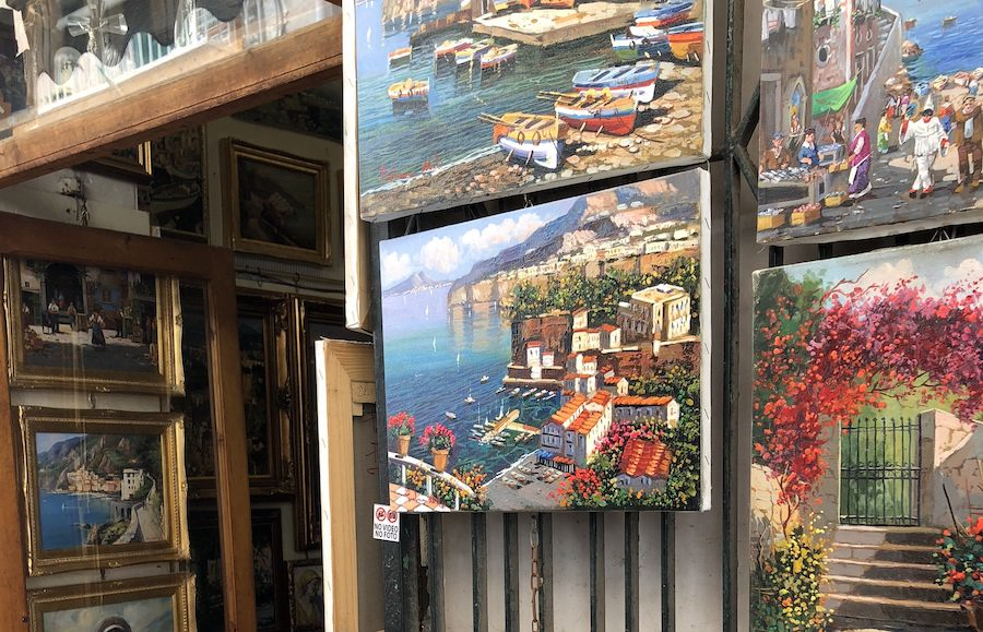 Paintings of Sorrrento hung in a shop