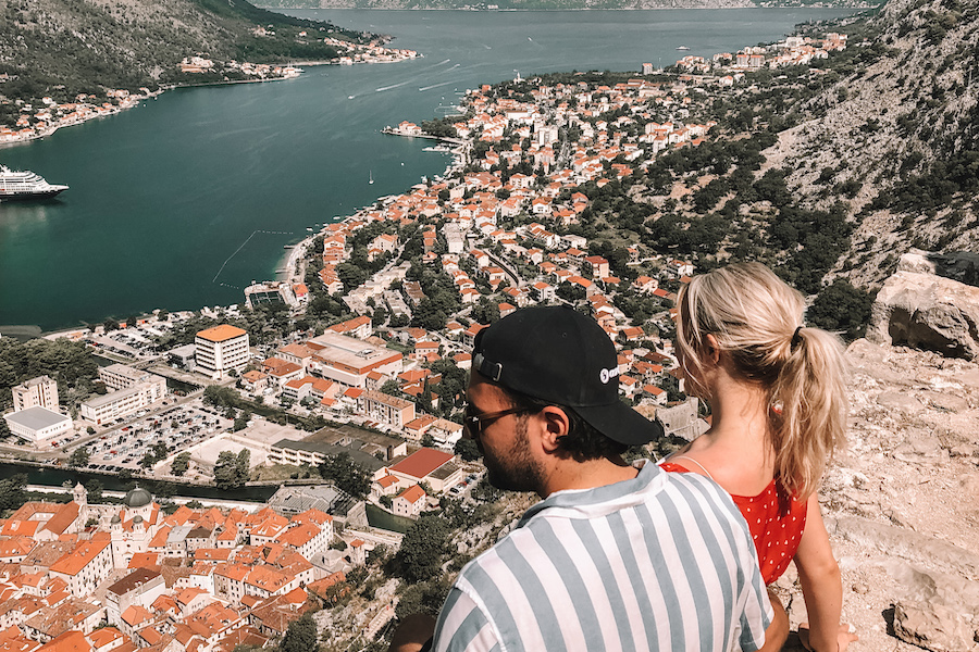 Couple sitting on the Kotor Fortress in Kotor, Montenegro