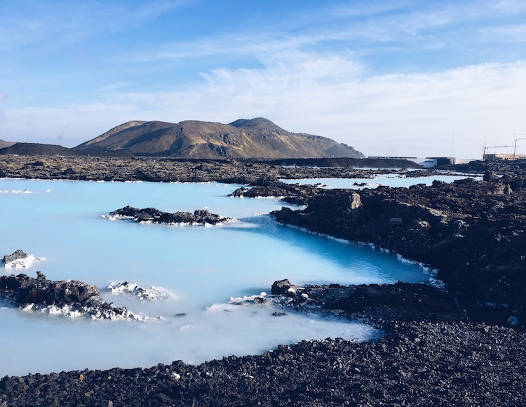 Blue water amongst the lava bedrock in Iceland