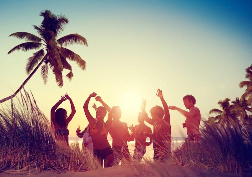 People dancing on the beach