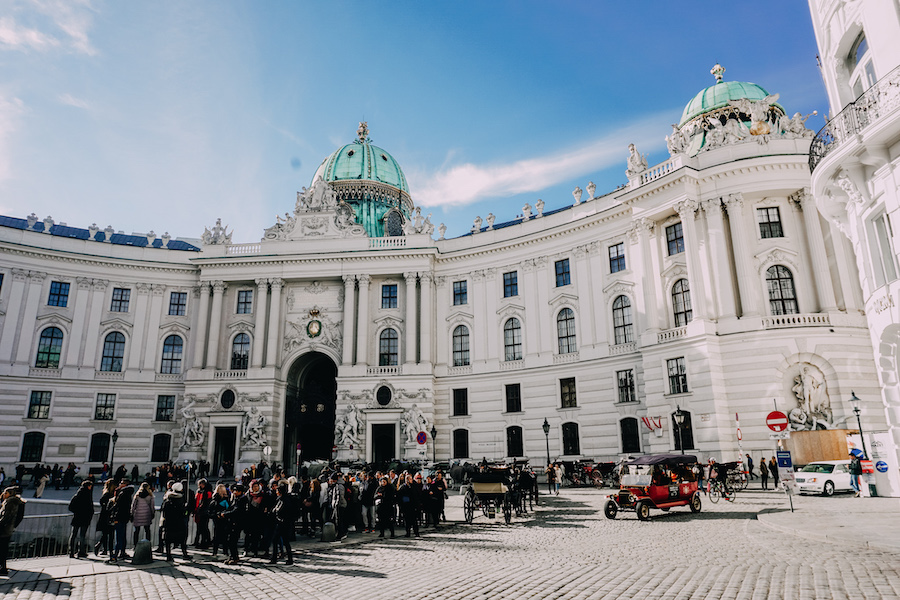 Front view of Hofburg Palace with people in front