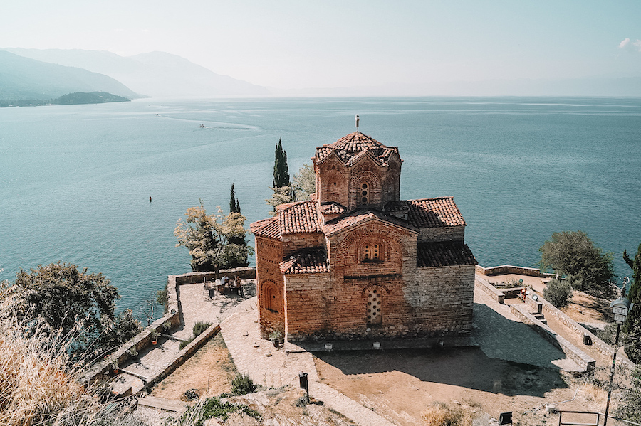 Lone church with water in the distance in the perfect balkan holiday spot Lake Ohrid