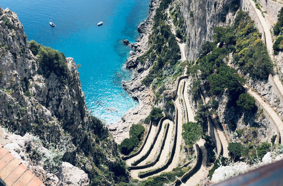 Ariel view of one of what to do in Capri, which is hiking a winding path up the Capri mountain side