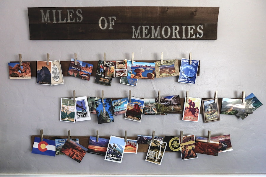 Postcards hung up as one of the best souvenir ideas