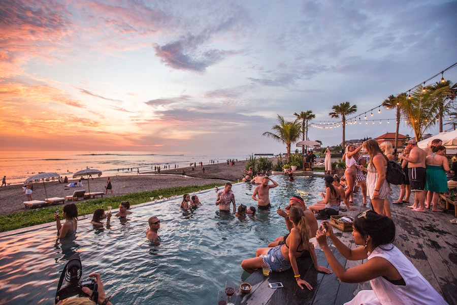 Sunset at a beach club in Bali