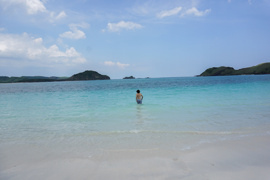 Man standing in the blue waters in Lombok