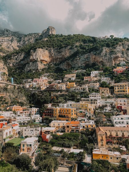 Pastel coloured buildings built on a mountain