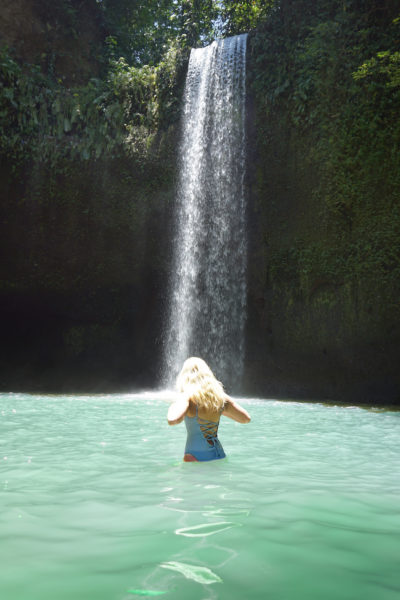 Tibumana Waterfall with girl infront