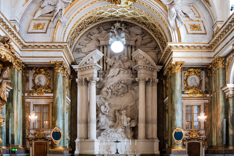 Royal Chapel interior with white marble statues and walls