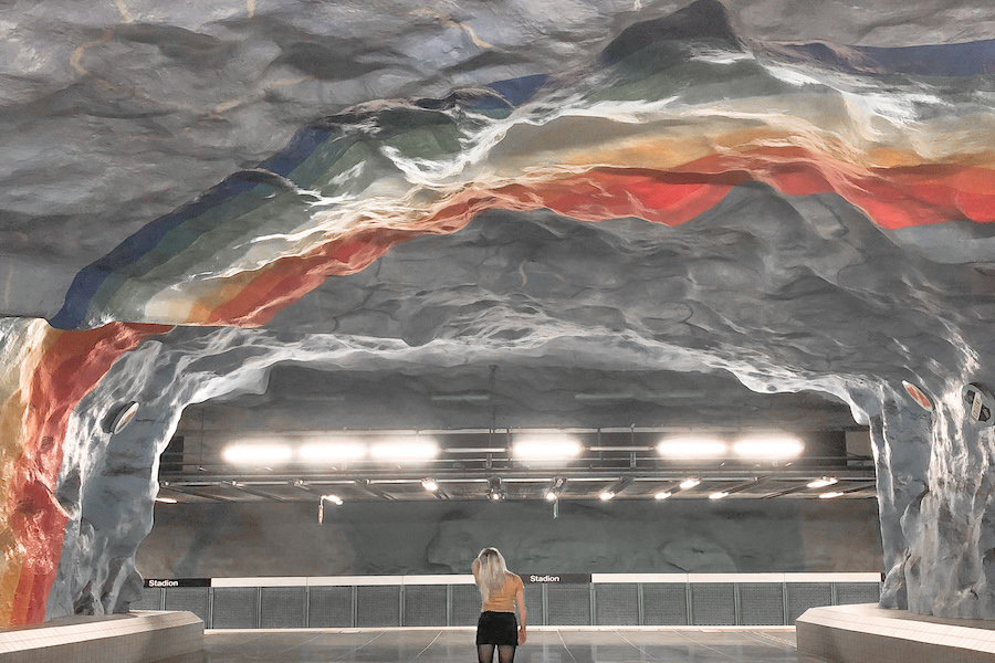 Stockholm subway art with rainbows painted onto the whole subway