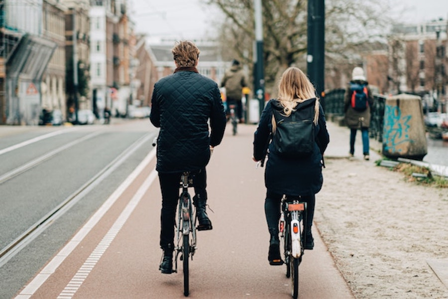 Two people biking in Amsterdam