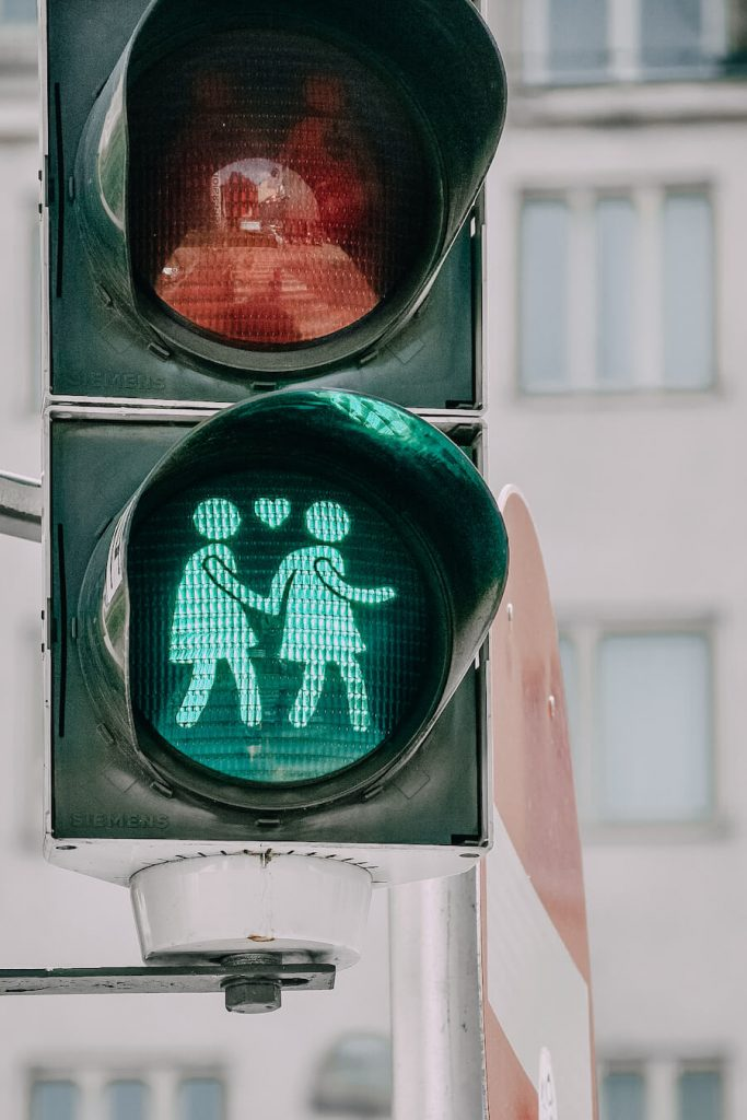 Street light with two women holding hands