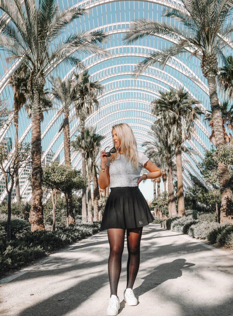 Girl infront of palm trees in Valencia, Spain