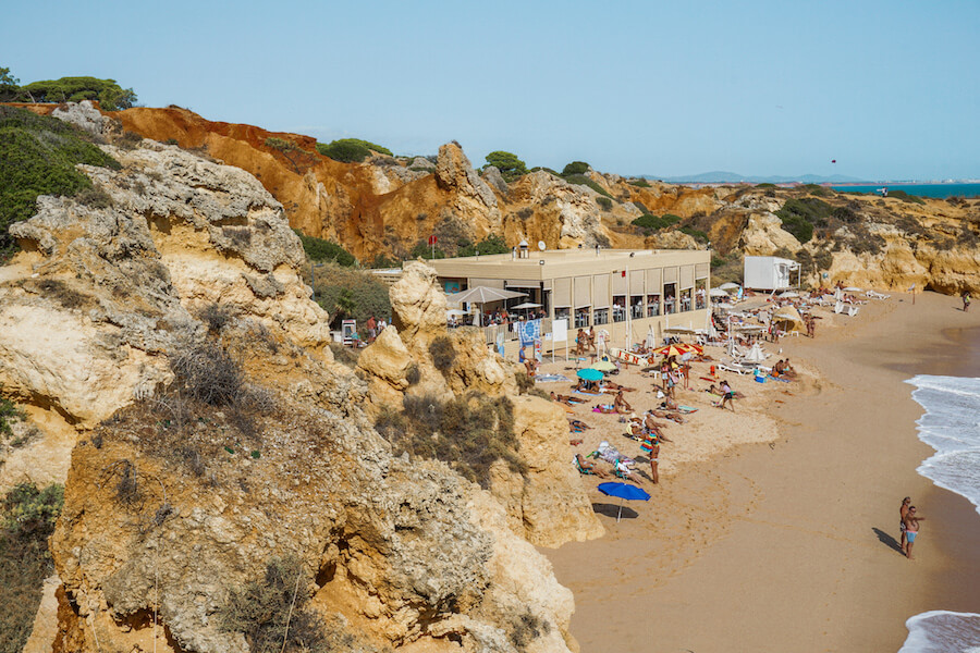 Beach surrounded by orange coloured rocks