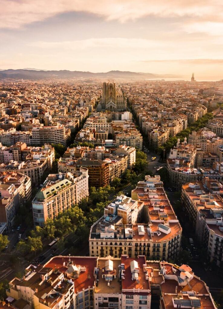 sunset over the buildings in Barcelona
