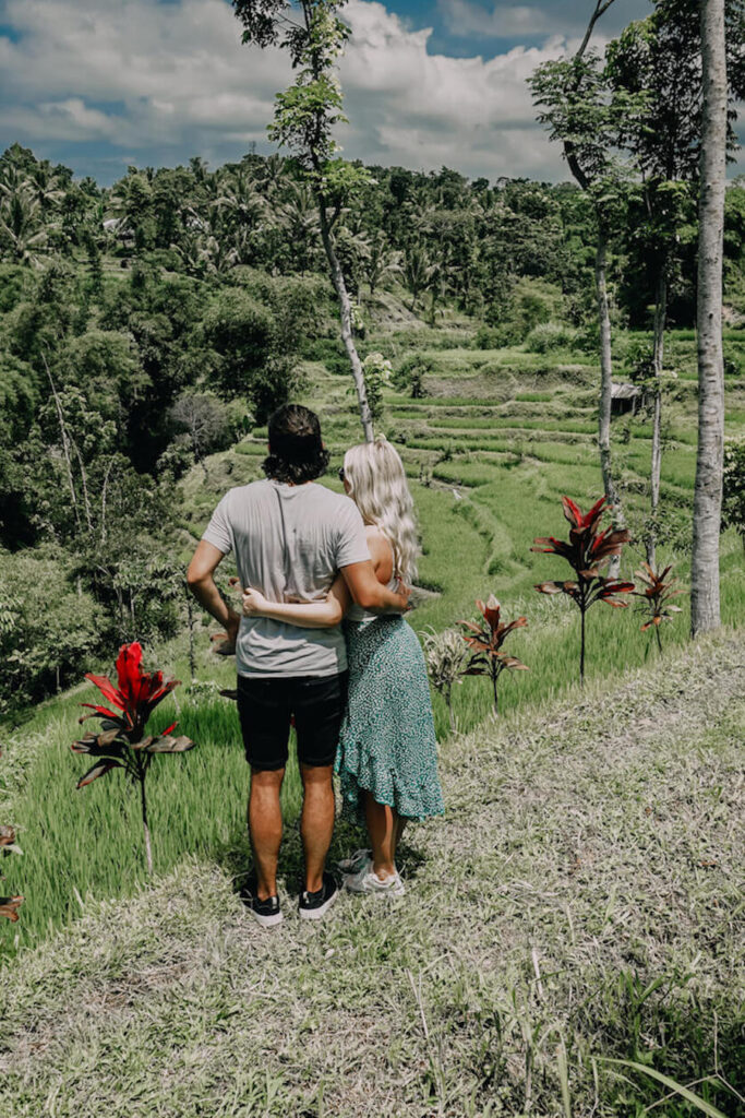 Two people standing in front of Rice Terraces