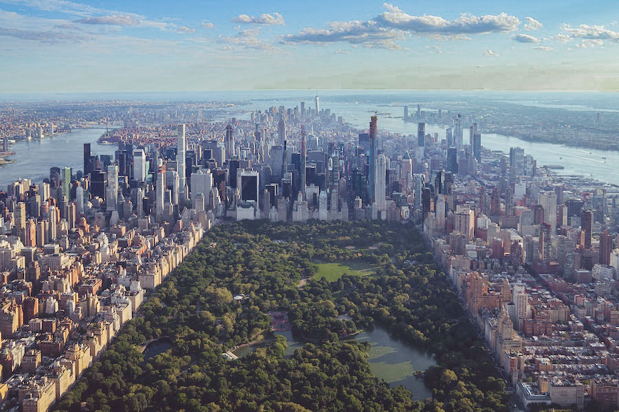 Ariel view of the green space of Central park surrounded by skyscrapers