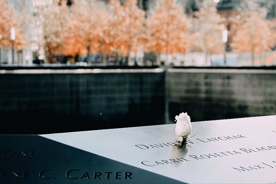9/11 memorial showing the names engraved on the black