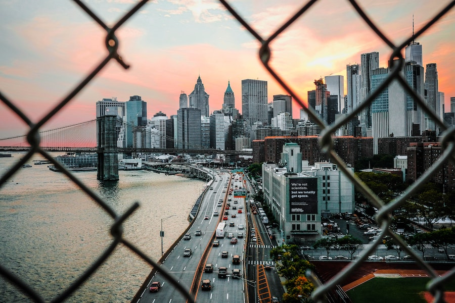 View of NYC through a chain link fence