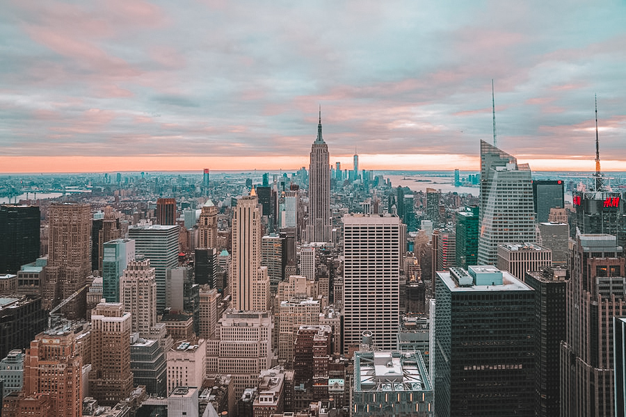 New York City skyline with a pink sunset