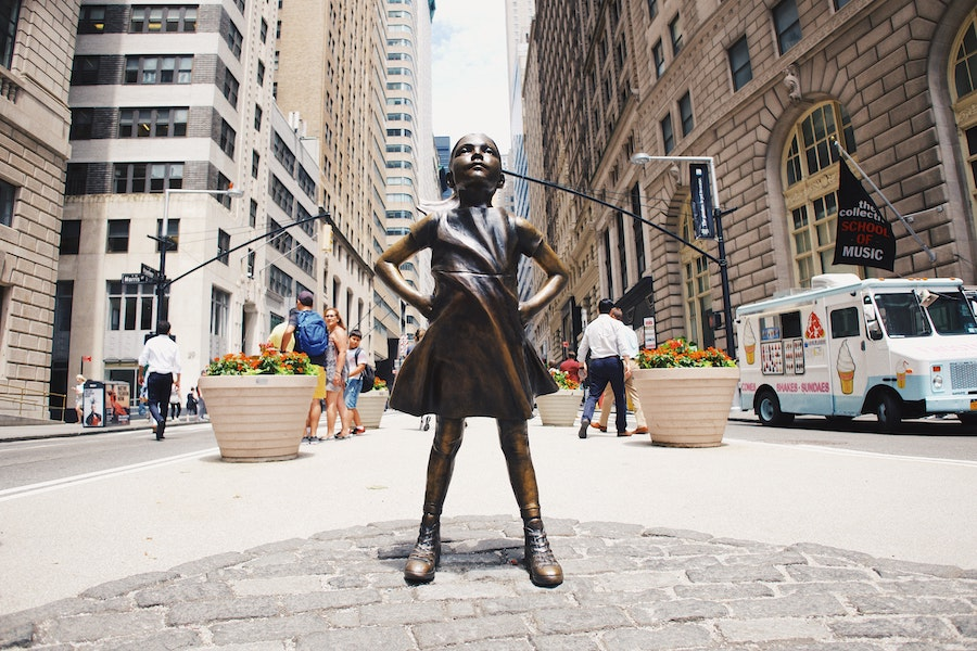 Statue of a little girl standing proud on Wall Street