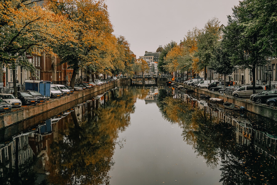 Canal with fall trees reflecting off the water