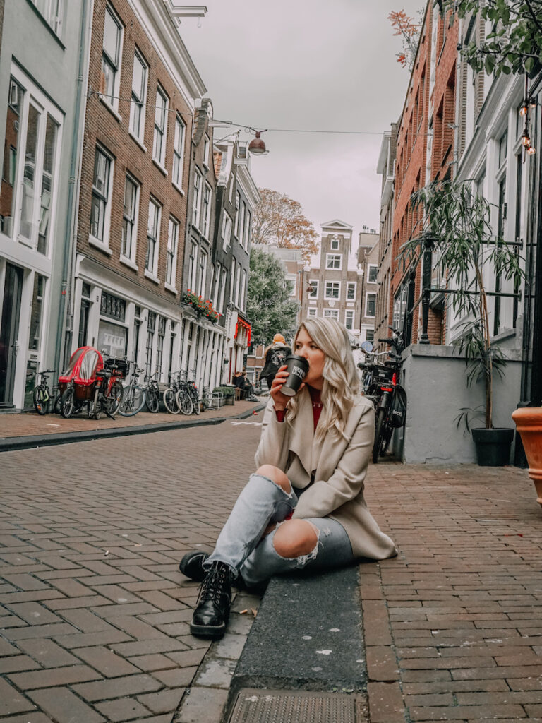 Girl sitting on the street in Amsterdam