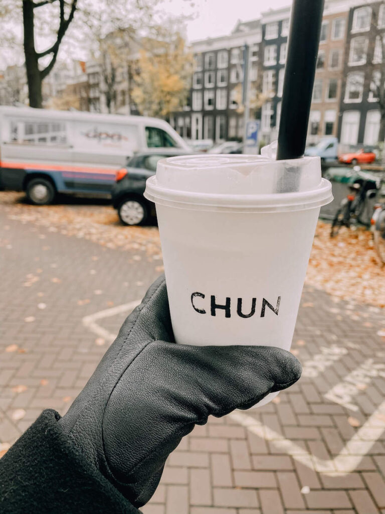 Bubble tea in a to o cup on the streets of Amsterdam